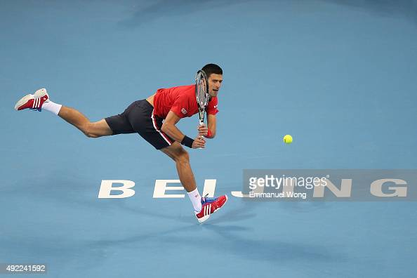 Novak Djokovic of Serbia returns a ball against Rafael Nadal of Spain during the Men's single final match on day 9 of the 2015 China Open at the...
