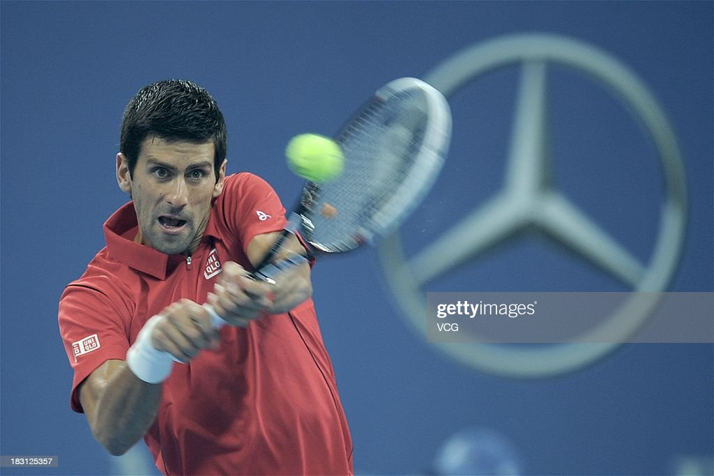 Novak Djokovic of Serbia returns a ball to Sam Querrey of the U.S. during day seven of the 2013 China Open at National Tennis Center on October 4, 2013 in Beijing, China.
