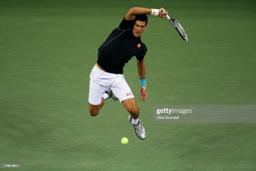 <a gi-track='captionPersonalityLinkClicked' href=/galleries/search?phrase=Novak+Djokovic&family=editorial&specificpeople=588315 ng-click='$event.stopPropagation()'>Novak Djokovic</a> of Serbia returns a forehand during his quarterfinal match against Mikhail Youzhny of Russia on Day Eleven of the 2013 US Open at USTA Billie Jean King National Tennis Center on September 5, 2013 in the Flushing neighborhood of the Queens borough of New York City.