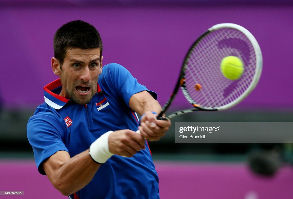<a gi-track='captionPersonalityLinkClicked' href=/galleries/search?phrase=Novak+Djokovic&family=editorial&specificpeople=588315 ng-click='$event.stopPropagation()'>Novak Djokovic</a> of Serbia returns a shot against Andy Murray of Great Britain in the Semifinal of Men's Singles Tennis on Day 7 of the London 2012 Olympic Games at Wimbledon on August 3, 2012 in London, England.