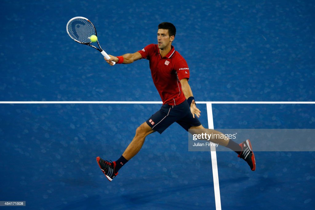 Novak Djokovic of Serbia returns a shot against Diego Schwartzman of Argentina during their men's singles first round match on Day One of the 2014 US Open at the USTA Billie Jean King National Tennis Center on August 25, 2014 in the Flushing neighborhood of the Queens borough of New York City.