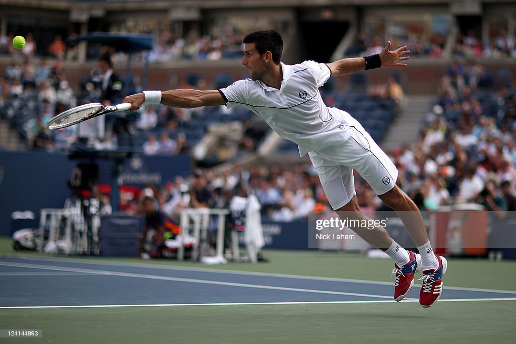 <a gi-track='captionPersonalityLinkClicked' href=/galleries/search?phrase=Novak+Djokovic&family=editorial&specificpeople=588315 ng-click='$event.stopPropagation()'>Novak Djokovic</a> of Serbia returns a shot against Janko Tipsarevic of Serbia during Day Eleven of the 2011 US Open at the USTA Billie Jean King National Tennis Center on September 8, 2011 in the Flushing neighborhood of the Queens borough of New York City.