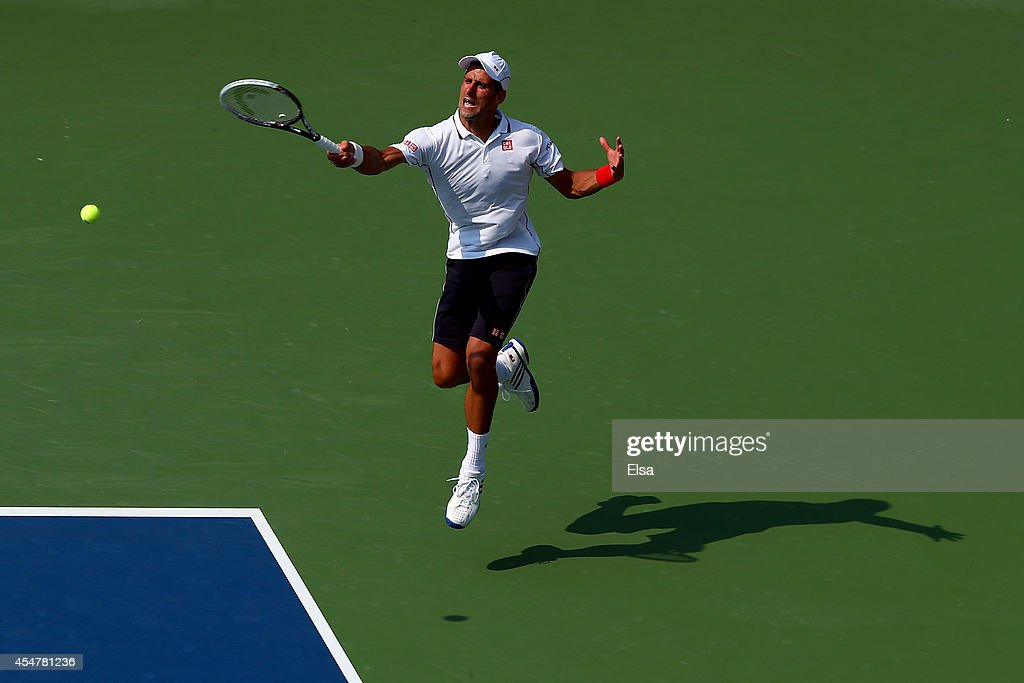 Novak Djokovic of Serbia returns a shot against Kei Nishikori of Japan during their men's singles semifinal match on Day Thirteen of the 2014 US Open...