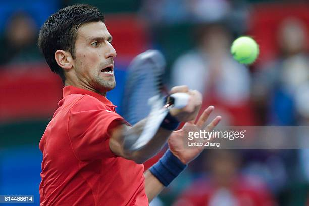 Novak Djokovic of Serbia returns a shot against Mischa Zverev of Germany during day six of Shanghai Rolex Masters at Qi Zhong Tennis Centre on...