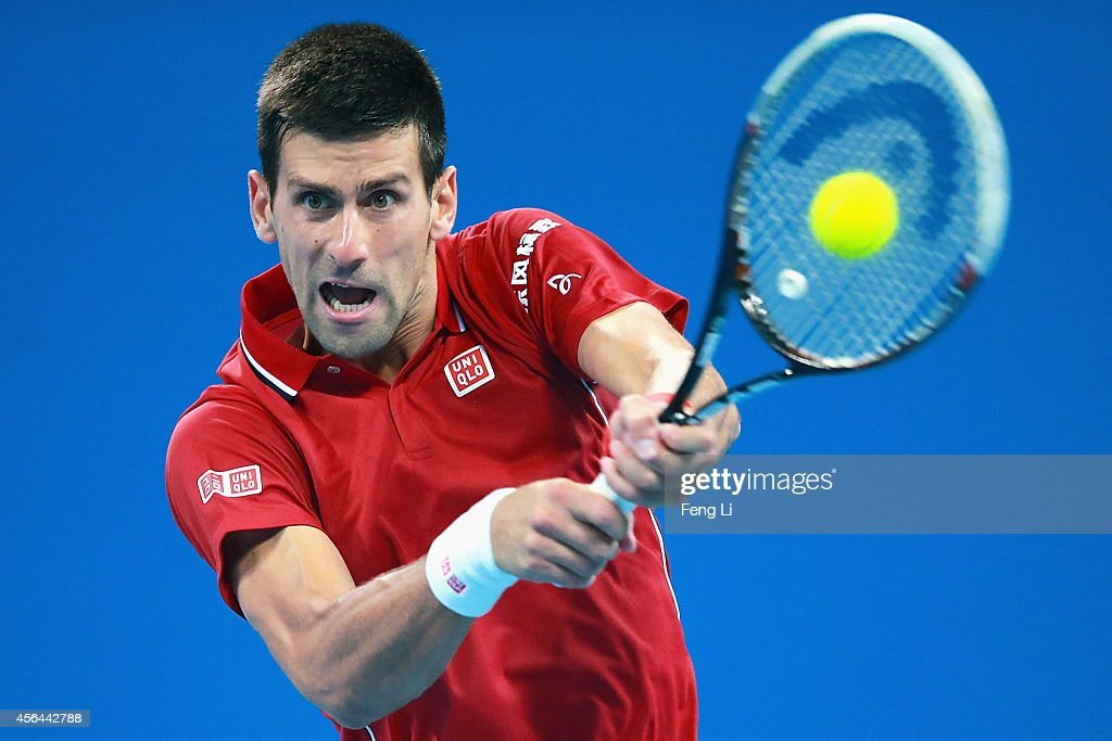 Novak Djokovic of Serbia returns a shot against Vasek Pospisil of Canada during day five of the China Open at the China National Tennis Center on October 1, 2014 in Beijing, China.