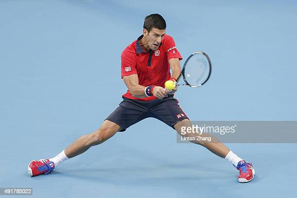 Novak Djokovic of Serbia returns a shot against Zhang Ze of China during the Men's singles second round match on day six of the 2015 China Open at...