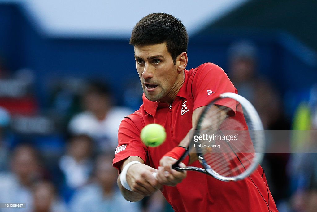 <a gi-track='captionPersonalityLinkClicked' href=/galleries/search?phrase=Novak+Djokovic&family=editorial&specificpeople=588315 ng-click='$event.stopPropagation()'>Novak Djokovic</a> of Serbia returns a shot during final match against Juan Martin Del Potro of Argentina during the day seven of the Shanghai Rolex Masters at the Qi Zhong Tennis Center on October 13, 2013 in Shanghai, China.