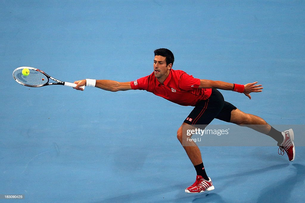 Novak Djokovic of Serbia returns a shot during his men's quarter-final match against Sam Querrey of United States on day seven of the 2013 China Open at the National Tennis Center on October 4, 2013 in Beijing, China.