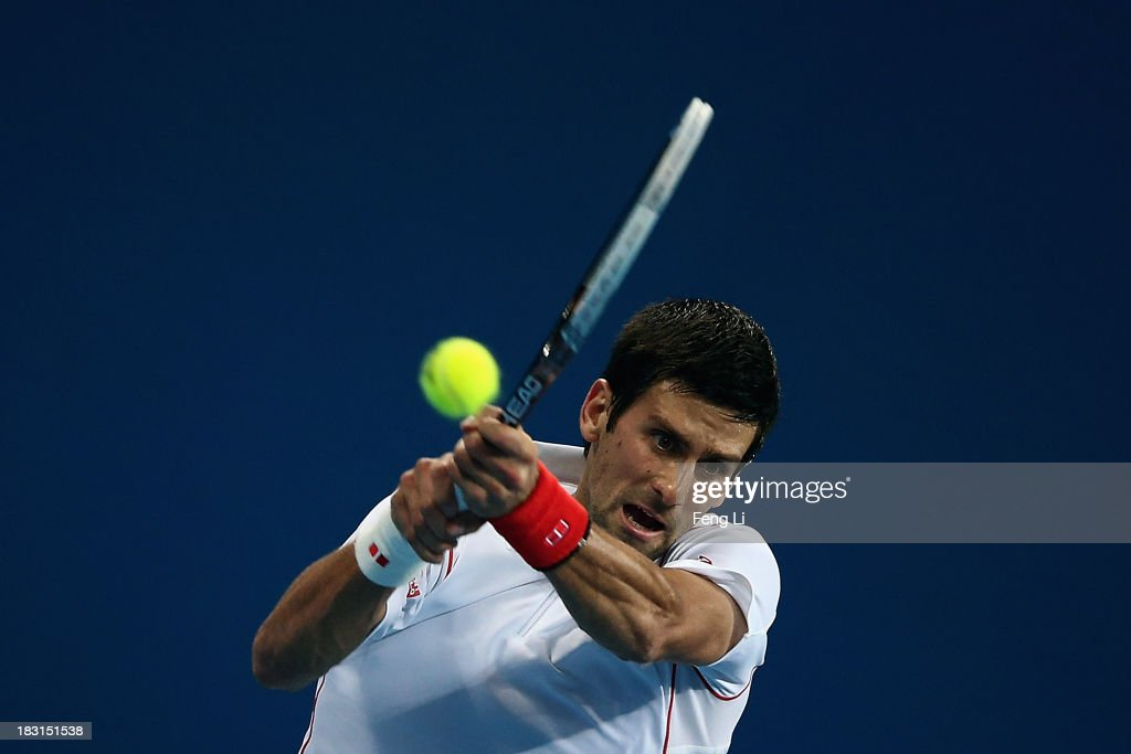 <a gi-track='captionPersonalityLinkClicked' href=/galleries/search?phrase=Novak+Djokovic&family=editorial&specificpeople=588315 ng-click='$event.stopPropagation()'>Novak Djokovic</a> of Serbia returns a shot during his men's semi-final match against Richard Gasquet of France on the eight day of 2013 China Open at the National Tennis Center on October 5, 2013 in Beijing, China.