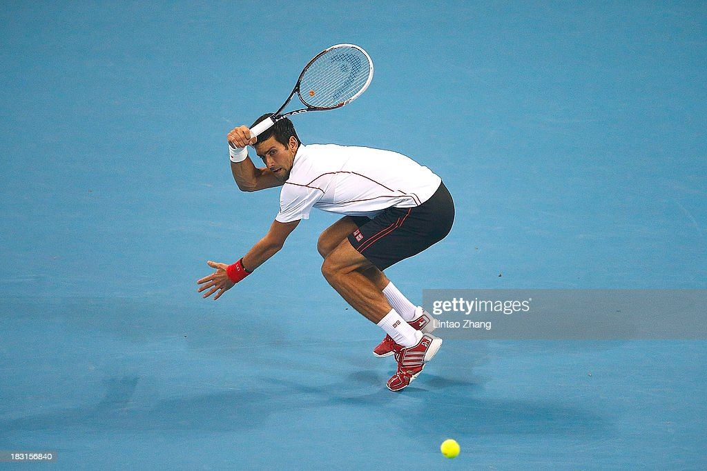 Novak Djokovic of Serbia returns a shot during his men's semi-final match against Richard Gasquet of France on day eight of the 2013 China Open at the National Tennis Center on October 5, 2013 in Beijing, China.