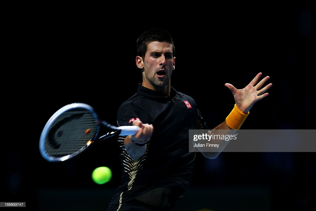 <a gi-track='captionPersonalityLinkClicked' href=/galleries/search?phrase=Novak+Djokovic&family=editorial&specificpeople=588315 ng-click='$event.stopPropagation()'>Novak Djokovic</a> of Serbia returns a shot during his men's singles match against Tomas Berdych of Czech Republic on day five of the ATP World Tour Finals at O2 Arena on November 9, 2012 in London, England.