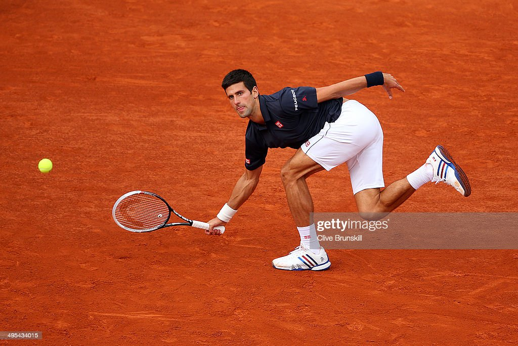 Novak Djokovic of Serbia returns a shot during his men's singles match against Milos Raonic of Canada on day ten of the French Open at Roland Garros on June 3, 2014 in Paris, France.