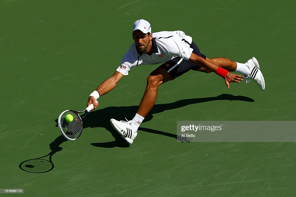 <a gi-track='captionPersonalityLinkClicked' href=/galleries/search?phrase=Novak+Djokovic&family=editorial&specificpeople=588315 ng-click='$event.stopPropagation()'>Novak Djokovic</a> of Serbia returns a shot during his men's singles semifinal match against David Ferrer of Spain on Day Fourteen of the 2012 US Open at USTA Billie Jean King National Tennis Center on September 9, 2012 in the Flushing neighborhood of the Queens borough of New York City.