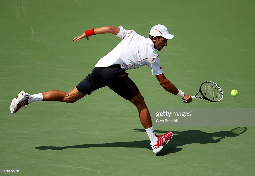 <a gi-track='captionPersonalityLinkClicked' href=/galleries/search?phrase=Novak+Djokovic&family=editorial&specificpeople=588315 ng-click='$event.stopPropagation()'>Novak Djokovic</a> of Serbia returns a shot during his men's singles second round match against Benjamin Becker of Germany on Day Five of the 2013 US Open at USTA Billie Jean King National Tennis Center on August 30, 2013 in the Flushing neighborhood of the Queens borough of New York City.