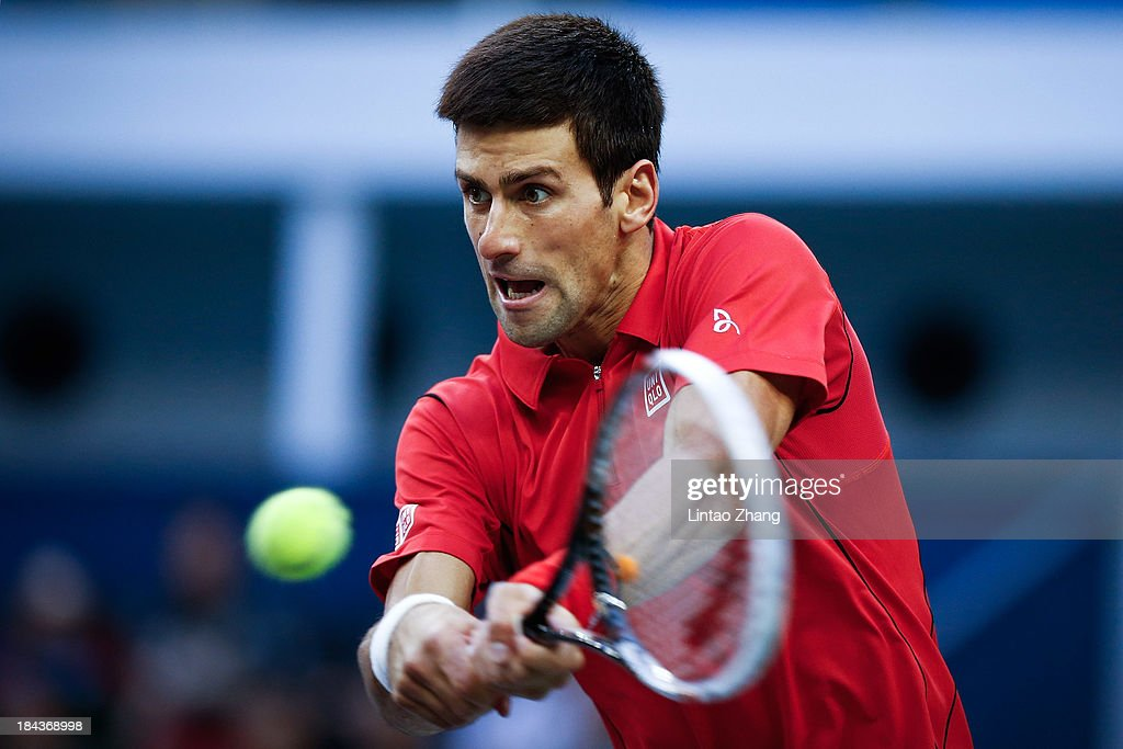 <a gi-track='captionPersonalityLinkClicked' href=/galleries/search?phrase=Novak+Djokovic&family=editorial&specificpeople=588315 ng-click='$event.stopPropagation()'>Novak Djokovic</a> of Serbia returns a shot during the final match against Juan Martin Del Potro of Argentina on day seven of the Shanghai Rolex Masters at the Qi Zhong Tennis Center on October 13, 2013 in Shanghai, China.