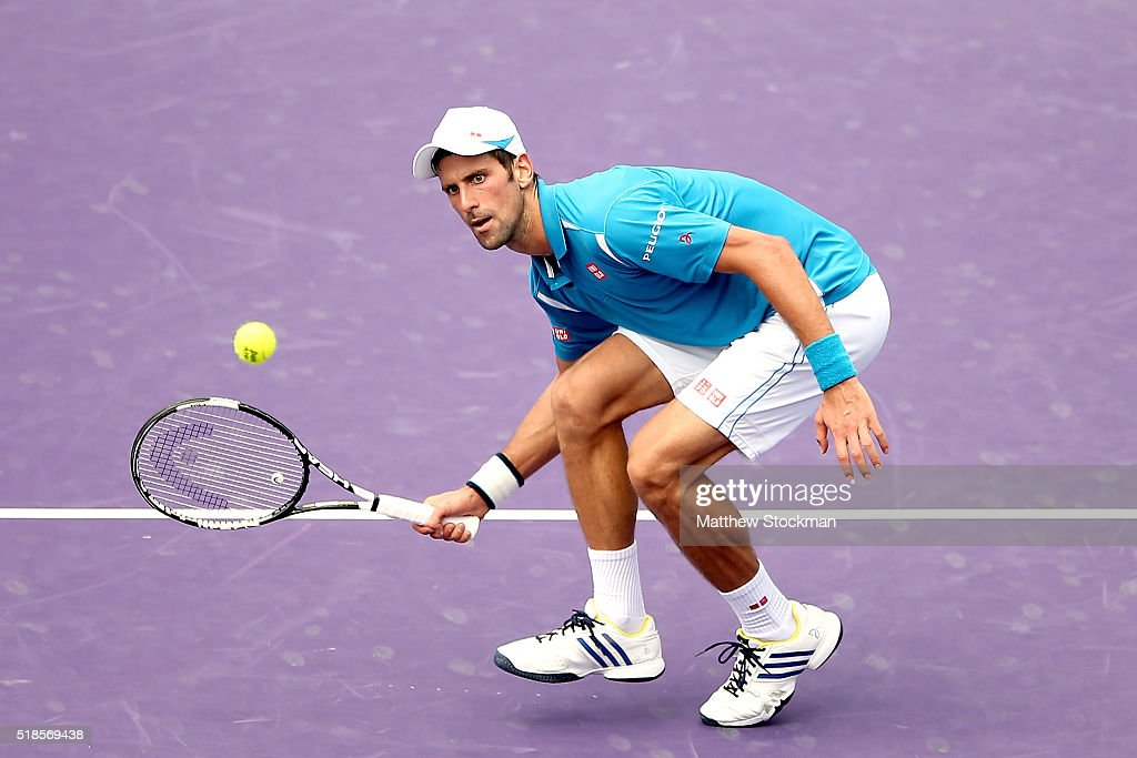 Novak Djokovic of Serbia returns a shot to David Goffin of Belgium during the semifinals of the Miami Open presented by Itau at Crandon Park Tennis...