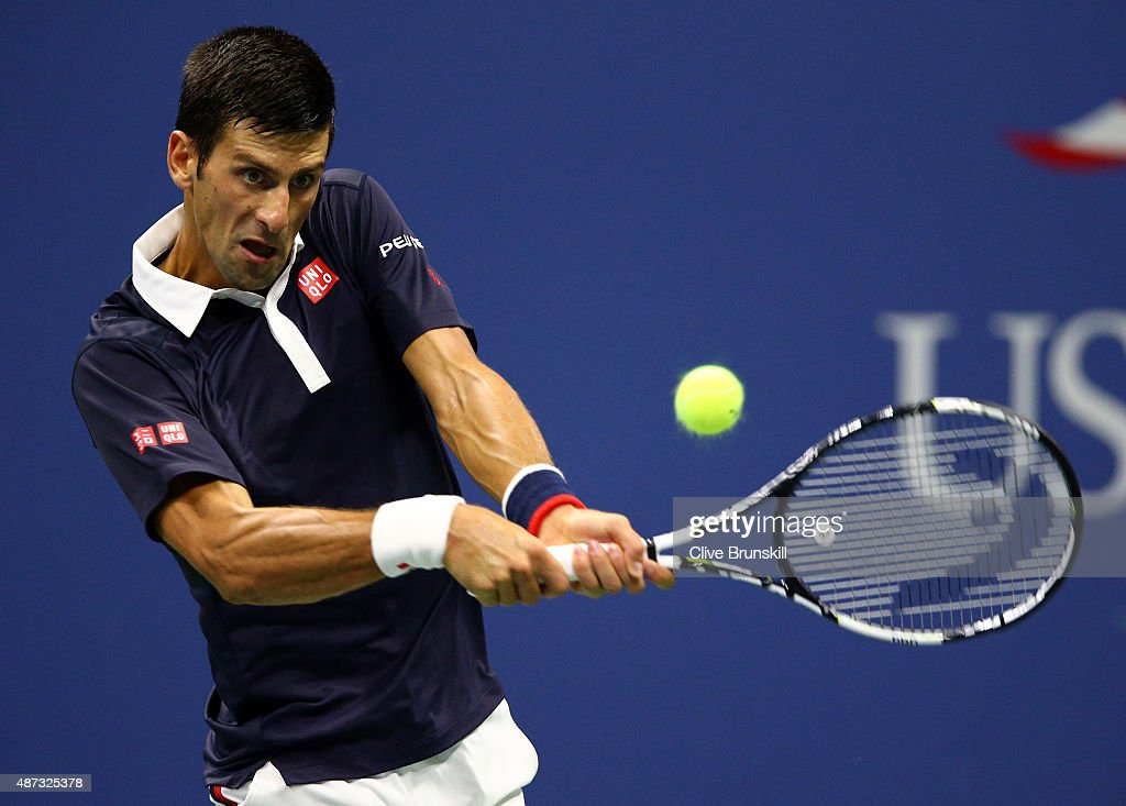Novak Djokovic of Serbia returns a shot to Feliciano Lopez of Spain during their Men's Singles Quarterfinals match on Day Nine of the 2015 US Open at the USTA Billie Jean King National Tennis Center on September 8, 2015 in the Flushing neighborhood of the Queens borough of New York City.