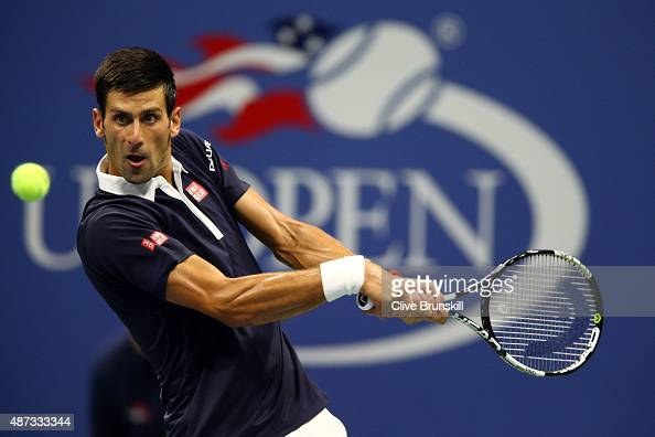 Novak Djokovic of Serbia returns a shot to Feliciano Lopez of Spain during their Men's Singles Quarterfinals match on Day Nine of the 2015 US Open at...