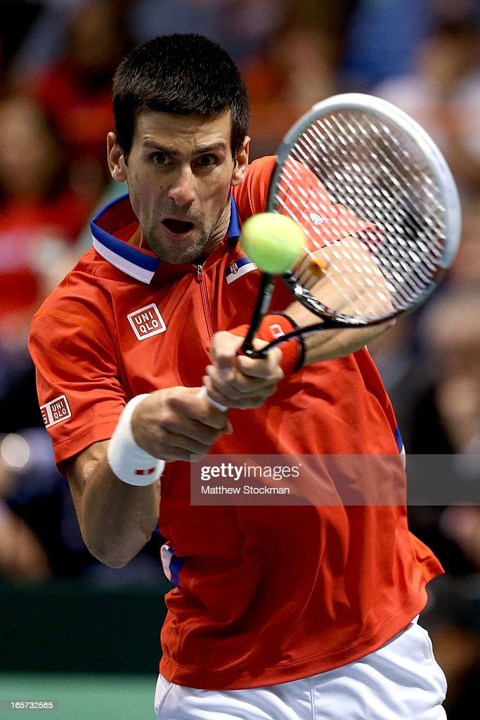 <a gi-track='captionPersonalityLinkClicked' href=/galleries/search?phrase=Novak+Djokovic&family=editorial&specificpeople=588315 ng-click='$event.stopPropagation()'>Novak Djokovic</a> of Serbia returns a shot to John Isner during the first match of the Davis Cup tie between the United States and Serbia at Taco Bell Arena on April 5, 2013 in Boise, Idaho.