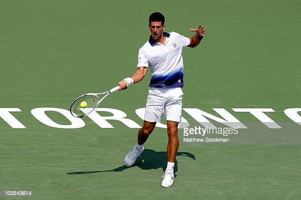 Novak Djokovic of Serbia returns a shot to Julien Benneteau of France during the Rogers Cup at the Rexall Centre on August 11 2010 in Toronto Canada