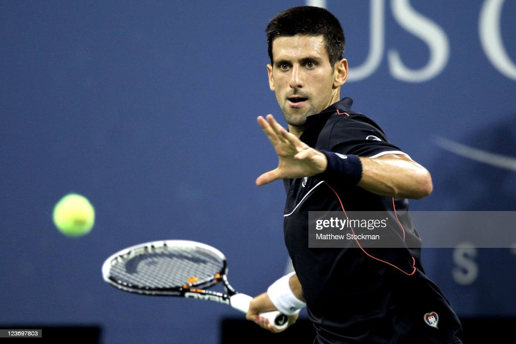 <a gi-track='captionPersonalityLinkClicked' href=/galleries/search?phrase=Novak+Djokovic&family=editorial&specificpeople=588315 ng-click='$event.stopPropagation()'>Novak Djokovic</a> of Serbia returns a shot to Nikolay Davydenko of Russia during Day Six of the 2011 US Open at the USTA Billie Jean King National Tennis Center on September 3, 2011 in the Flushing neighborhood of the Queens borough of New York City.