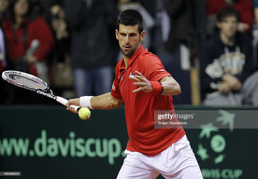 Novak Djokovic of Serbia returns a shot to Olivier Rochus of Belgium during the Davis Cup singles first round match between Belgium and Serbia, at Spirou dome February 01, 2013 in Charleroi, Belgium.