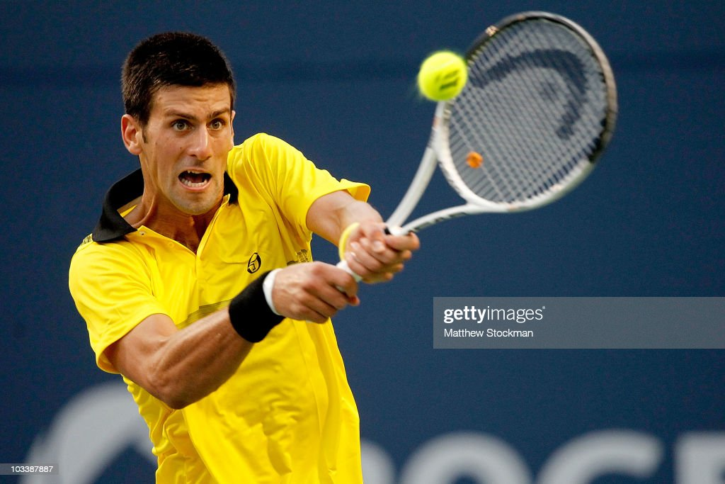 <a gi-track='captionPersonalityLinkClicked' href=/galleries/search?phrase=Novak+Djokovic&family=editorial&specificpeople=588315 ng-click='$event.stopPropagation()'>Novak Djokovic</a> of Serbia returns a shot to Roger Federer of Switzerland during the semifinals of the Rogers Cup at the Rexall Centre on August 14, 2010 in Toronto, Canada.