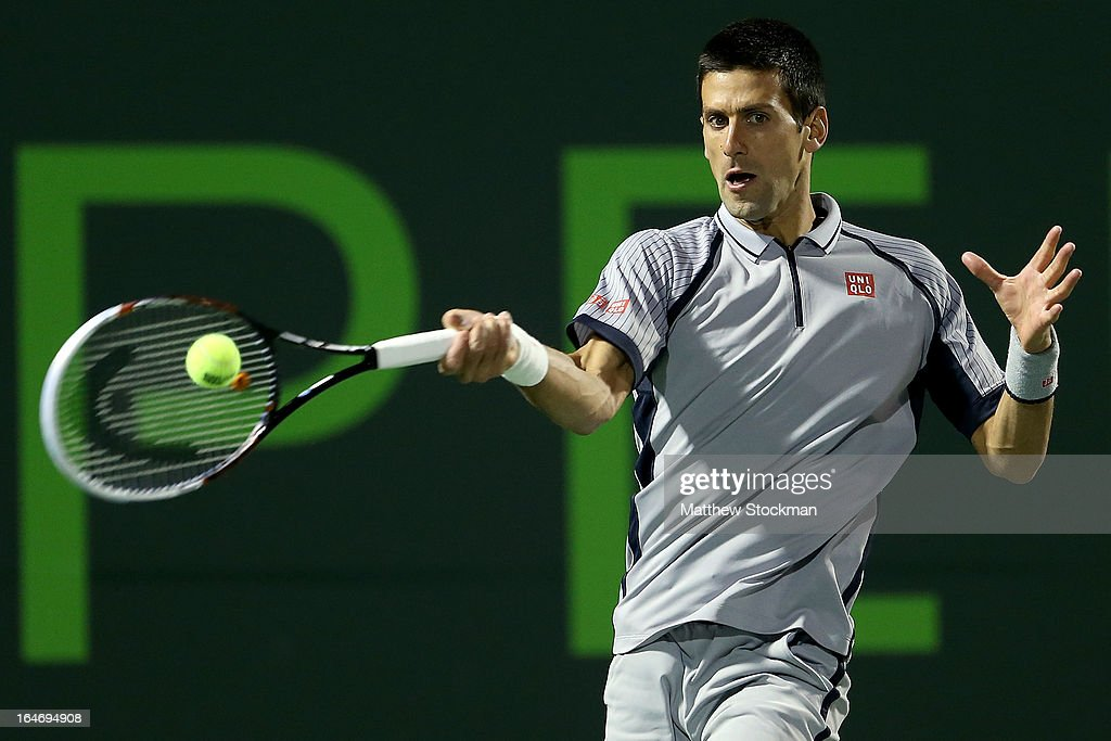 <a gi-track='captionPersonalityLinkClicked' href=/galleries/search?phrase=Novak+Djokovic&family=editorial&specificpeople=588315 ng-click='$event.stopPropagation()'>Novak Djokovic</a> of Serbia returns a shot to Tommy Haas of Germany during the Sony Open at Crandon Park Tennis Center on March 26, 2013 in Key Biscayne, Florida.
