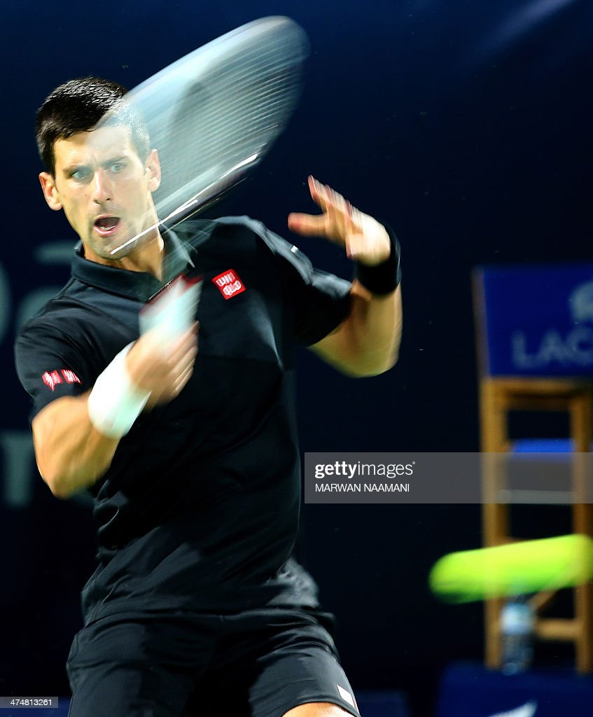 Novak Djokovic of Serbia returns the ball to Denis Istomim of Uzbekistan during their tennis match in the second day of the Dubai Duty Free Tennis Championships on February 25, 2014.
