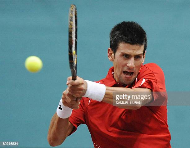 Novak Djokovic of Serbia returns the ball to Dominik Hrbaty of Slovakia during their Davis Cup match on September 19 2008 in Bratislava AFP...