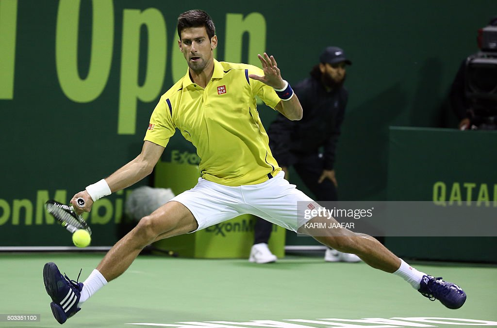 TOPSHOT Novak Djokovic of Serbia returns the ball to Germany's Dustin Brown during their tennis match in the Qatar Open competition on January 4 in...