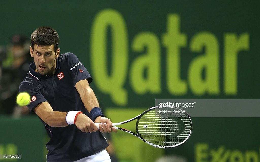 Novak Djokovic of Serbia returns the ball to Sergiy Stakhovsky of the Ukraine during their tennis match in Qatar's ExxonMobil Open in Doha on January...