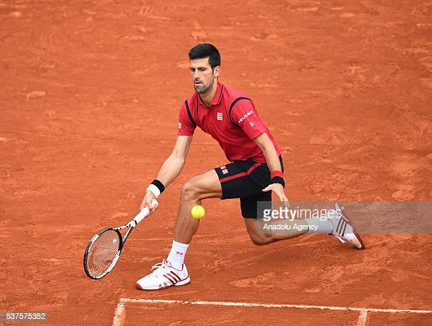 Novak Djokovic of Serbia returns to Tomas Berdych of Czech Republic during the men's single quarter final match at the French Open tennis tournament...