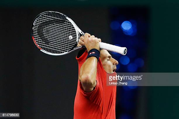 Novak Djokovic of Serbia rips his shirt off after losing the point against Roberto Bautista Agut of Spain during the Men's singles Semifinals match...