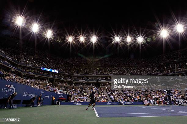 Novak Djokovic of Serbia rserves against Carlos Berlocq of Argentina during Day Four of the 2011 US Open at the USTA Billie Jean King National Tennis...