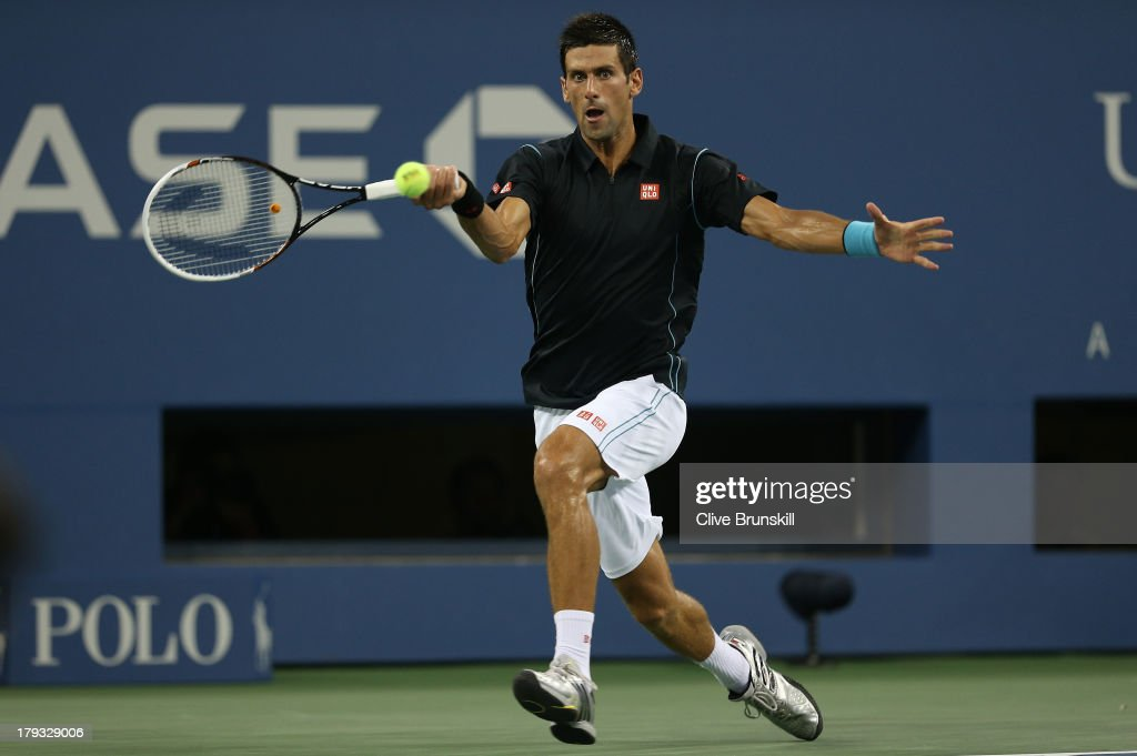 <a gi-track='captionPersonalityLinkClicked' href=/galleries/search?phrase=Novak+Djokovic&family=editorial&specificpeople=588315 ng-click='$event.stopPropagation()'>Novak Djokovic</a> of Serbia runs to play a forehand against Joao Sousa of Portugal during the third round match on Day Seven of the 2013 US Open at USTA Billie Jean King National Tennis Center on September 1, 2013 in the Flushing neighborhood of the Queens borough of New York City.
