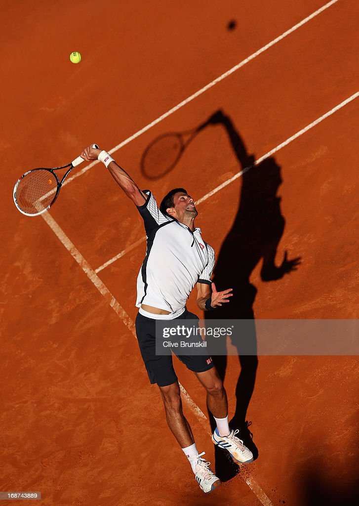 <a gi-track='captionPersonalityLinkClicked' href=/galleries/search?phrase=Novak+Djokovic&family=editorial&specificpeople=588315 ng-click='$event.stopPropagation()'>Novak Djokovic</a> of Serbia serves against AlbertMontanes of Spain in their second round match during day three of the Internazionali BNL d'Italia 2013 at the Foro Italico Tennis Centre on May 14, 2013 in Rome, Italy.