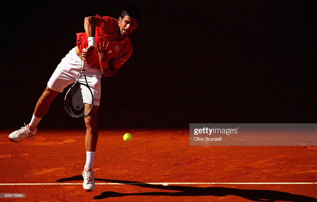 <a gi-track='captionPersonalityLinkClicked' href=/galleries/search?phrase=Novak+Djokovic&family=editorial&specificpeople=588315 ng-click='$event.stopPropagation()'>Novak Djokovic</a> of Serbia serves against Borna Coric of Croatia in their second round match during day five of the Mutua Madrid Open tennis tournament at the Caja Magica on May 04, 2016 in Madrid.