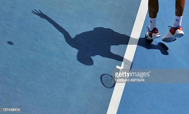 Novak Djokovic of Serbia serves against Nicolas Mahut of France in their third round men's singles match on day six of the 2012 Australian Open...