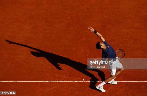 Novak Djokovic of Serbia serves against Pablo Carreno Busta of Spain in his third round match on day five of the Monte Carlo Rolex Masters at...