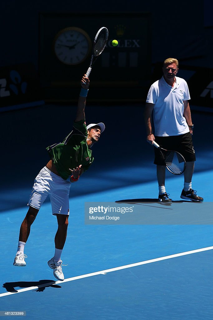 <a gi-track='captionPersonalityLinkClicked' href=/galleries/search?phrase=Novak+Djokovic&family=editorial&specificpeople=588315 ng-click='$event.stopPropagation()'>Novak Djokovic</a> of Serbia serves as coach <a gi-track='captionPersonalityLinkClicked' href=/galleries/search?phrase=Boris+Becker&family=editorial&specificpeople=67204 ng-click='$event.stopPropagation()'>Boris Becker</a> looks on during a practice session ahead of the 2014 Australian Open at Melbourne Park on January 8, 2014 in Melbourne, Australia.