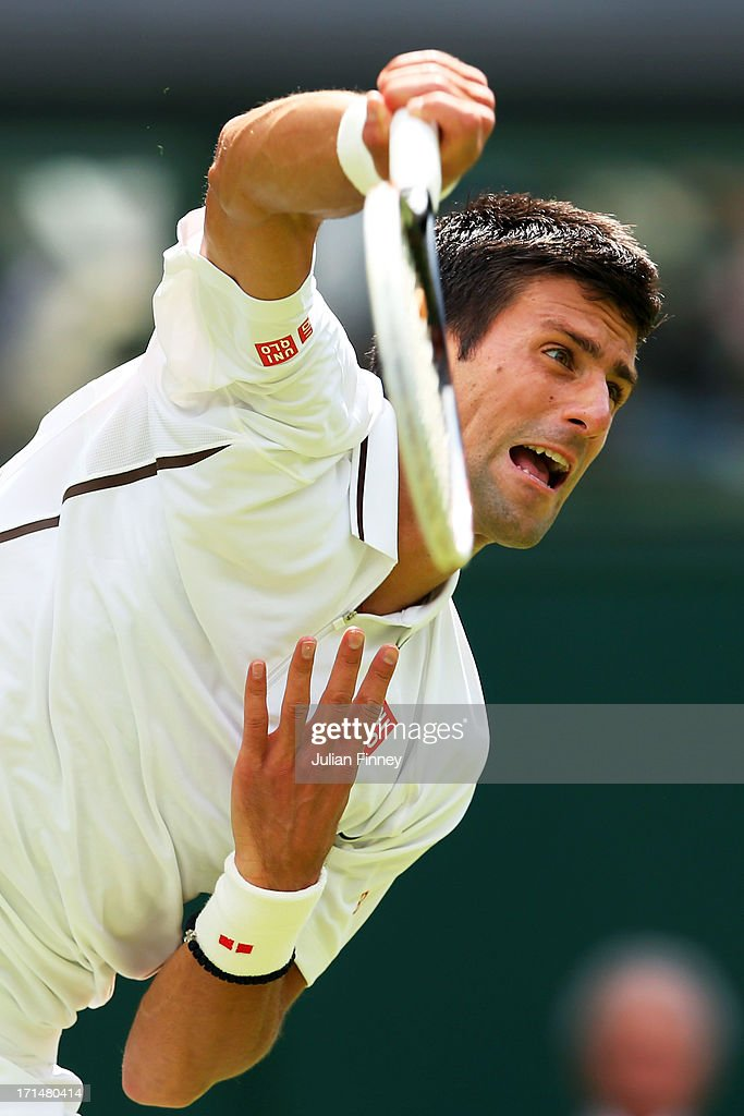 Novak Djokovic of Serbia serves during his Gentlemen's Singles first round match against Florian Mayer of Germany on day two of the Wimbledon Lawn Tennis Championships at the All England Lawn Tennis and Croquet Club on June 25, 2013 in London, England.