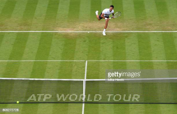 Novak Djokovic of Serbia serves during his mens singles final against Gael Monfils of France on day seven of the Aegon International Eastbourne at...