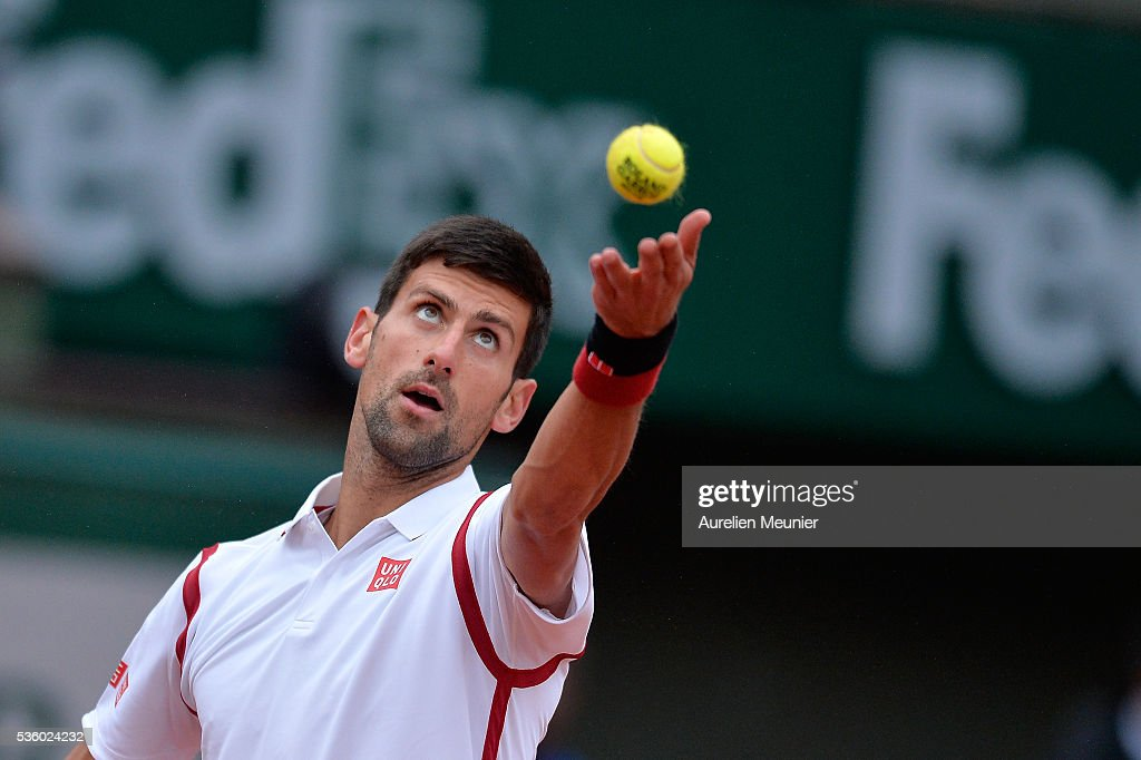 Novak Djokovic of Serbia serves during his men's singles fourth round match against Roberto Bautista Agut of Spain on day ten of the 2016 French Open at Roland Garros on May 31, 2016 in Paris, France.