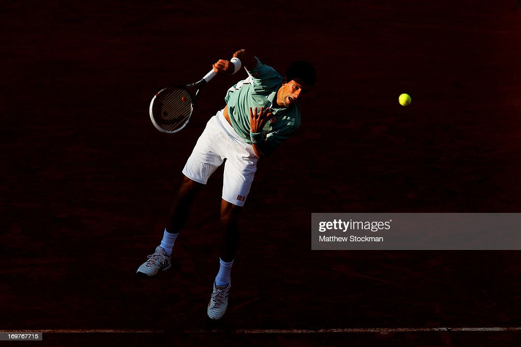 Novak Djokovic of Serbia serves during his Men's Singles match against Grigor Dimitrov of Bulgaria on day seven of the French Open at Roland Garros on June 1, 2013 in Paris, France.