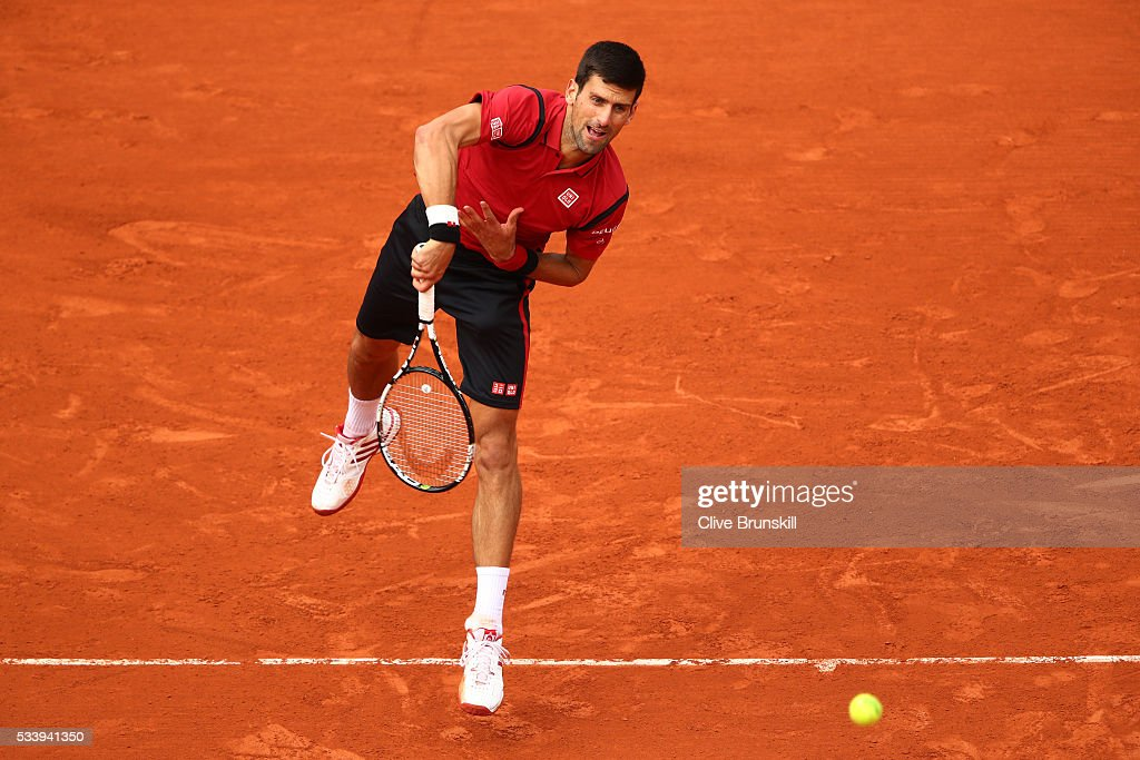 <a gi-track='captionPersonalityLinkClicked' href=/galleries/search?phrase=Novak+Djokovic&family=editorial&specificpeople=588315 ng-click='$event.stopPropagation()'>Novak Djokovic</a> of Serbia serves during the Men's Singles first round match against Yen-Hsun Lu of Taipei on day three of the 2016 French Open at Roland Garros on May 24, 2016 in Paris, France.