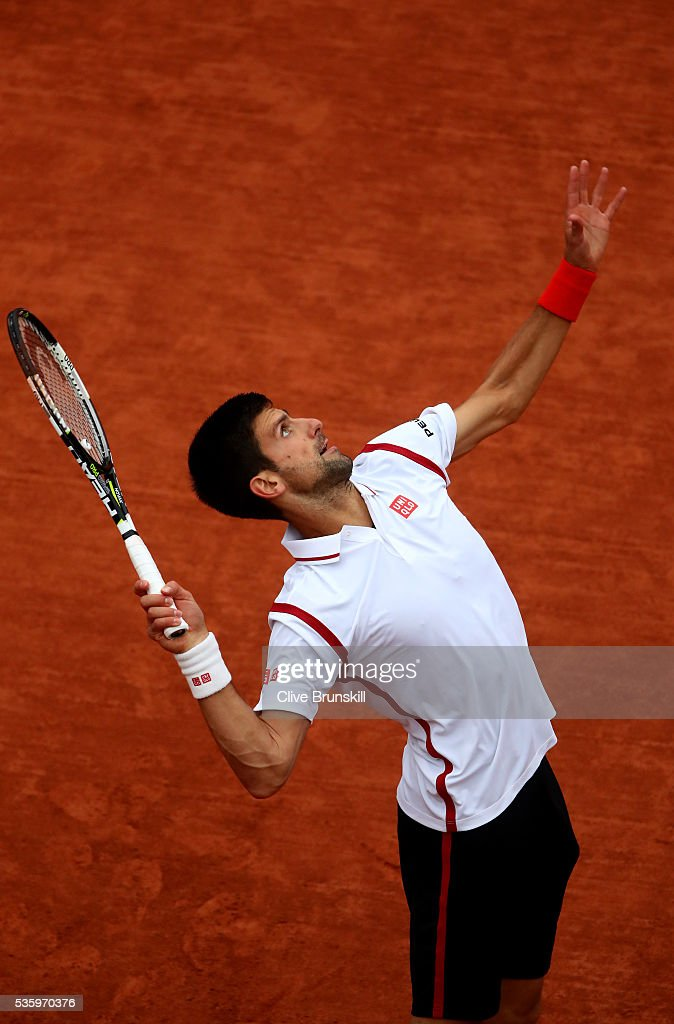 <a gi-track='captionPersonalityLinkClicked' href=/galleries/search?phrase=Novak+Djokovic&family=editorial&specificpeople=588315 ng-click='$event.stopPropagation()'>Novak Djokovic</a> of Serbia serves during the Men's Singles fourth round match against Roberto Bautista Agut of Spain on day ten of the 2016 French Open at Roland Garros on May 31, 2016 in Paris, France.