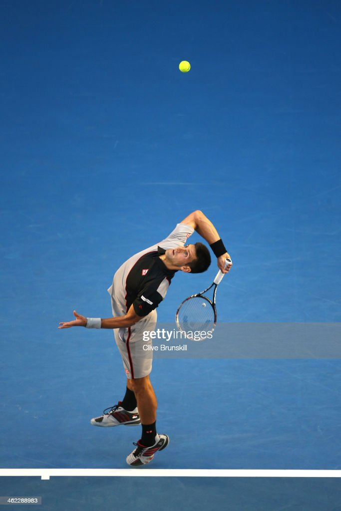 <a gi-track='captionPersonalityLinkClicked' href=/galleries/search?phrase=Novak+Djokovic&family=editorial&specificpeople=588315 ng-click='$event.stopPropagation()'>Novak Djokovic</a> of Serbia serves in his first round match against Lukas Lacko of Slovakia during day one of the 2014 Australian Open at Melbourne Park on January 13, 2014 in Melbourne, Australia.