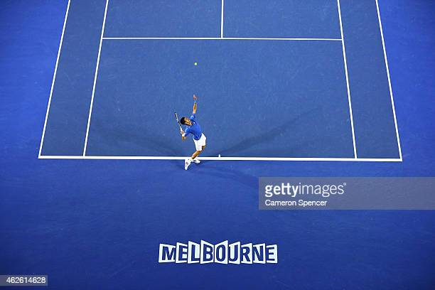 Novak Djokovic of Serbia serves in his men's final match against Andy Murray of Great Britain during day 14 of the 2015 Australian Open at Melbourne...