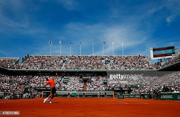 Novak Djokovic of Serbia serves in the Men's Singles Final against Stanislas Wawrinka of Switzerland on day fifteen of the 2015 French Open at Roland...